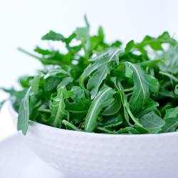 A Salad of Arugula Leaves in a bowl.  Shallow dof