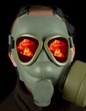 Gas mask with reflections of nuclear mushroom on eye visors