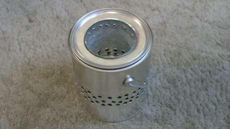 Homemade gallon can wood stove tin can wood stove for Tin can rocket stove