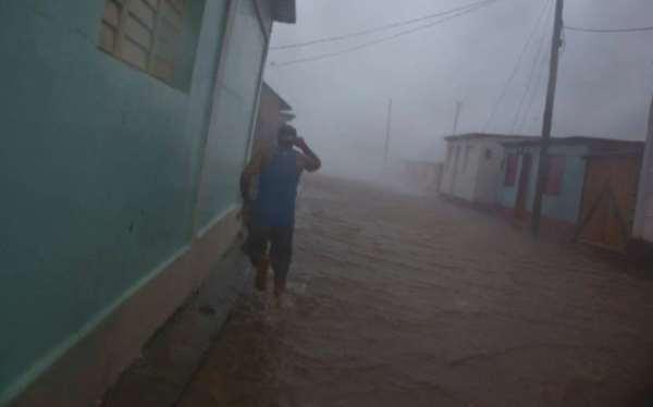 110402200_a_resident_runs_in_as_flooded_street_as_hurricane_matthew_roars_over_baracoa_cuba_tues-large_transgo3npzuhtl7qit9kbjy-j1ncutiyj9-baduoj2tcay
